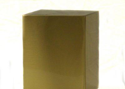 bronze cube on white